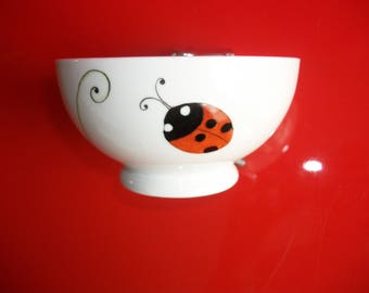 "Child's porcelain bowl decorated with ""Clover and ladybugs"""
