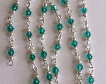 55cm of string/bicones 4mm dark green glass