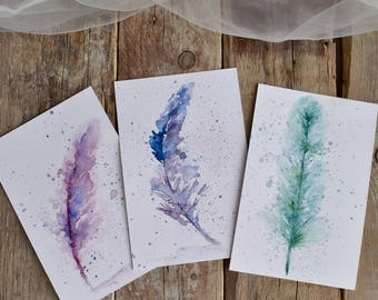 Three Postcards with Feathers