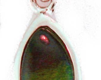 Simple Marquise Shaped  Canadian Ammolite Pendant set in  Sterling Silver.