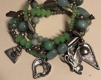 Green and silver beaded charm bracelet