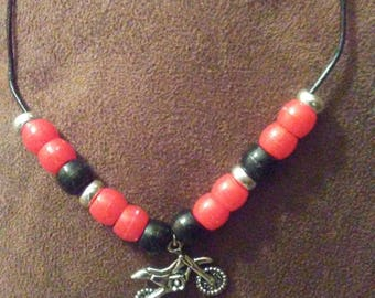 Motocross necklace with dirtbike pendant and CR colored beads on leather cord.