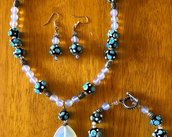 Glass necklace, bracelet, and earring set