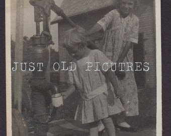 Little Girls at the water pump getting a drink old vintage photo/snapshot/photograph old photos-e225