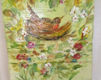 Painted bird in nest with flowers on wood