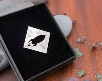 Retro Rocket Brooch - a simple, square brooch with iconic space rocket design
