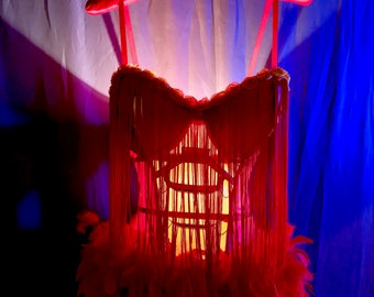 Hand Made Tramp Lamp crafted from Red and Gold Iron WoMan Bustier Trimmed in Yellow floral Toile and red fringe at bust with red feathers