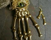 SOLD Gothic Steampunk Golden Skeleton Hand with Green Eye Necklace with Matching Earrings