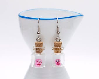 Origami Kirby earrings in tiny glass bottle