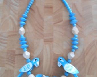 Vintage 1960s blue & beige wooden oversized parrot necklace