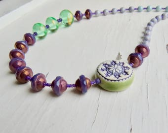 Starry Eyed - handmade artisan bead necklace in purple and mint green with handmade ceramic and lampwork glass beads - Songbead, UK