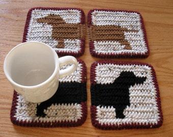 Dachshund Coasters. Crochet coaster set with black and brown dachshund dog silhouettes. Wiener dog decor
