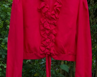 vintage blouse 1960's,in red with ruffle/frill detail to front,ties at the waist.