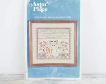 Vintage Alphabet Counted Cross Stitch Sampler Kit w/ Cat design by Astor Place