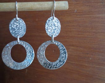 Dangling .925 silver earrings.