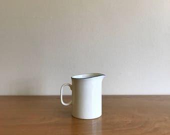 small white ceramic creamer