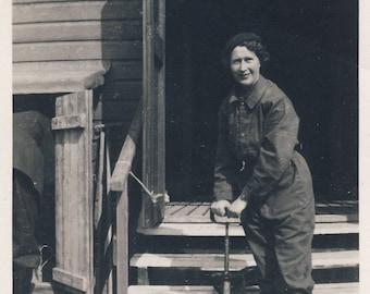 Woman using stirrup pump, Home Front, Vintage photograph 1940s