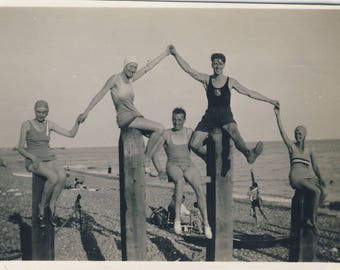 Group posing in swimwear on beach at Hove, Vintage photograph c1930s