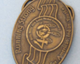 """Belt Buckle, 3 X 2 inches, """"Running Strong for American Indian Youth"""