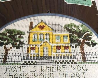 """Vintage """"Home is where you hang your heart"""" oval cross stitch kit. Yellow house cross stitch"""