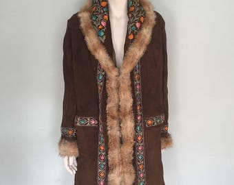 Beautiful 1970's embroidered suede coat with fur trim