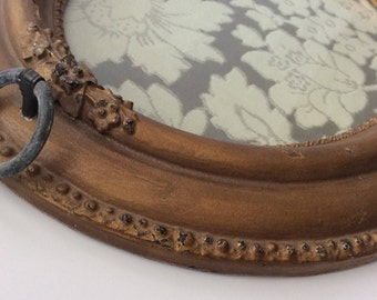 Upcycled vintage gold oval frame tray with vintage ring handles and grey and cream floral upholstery fabric