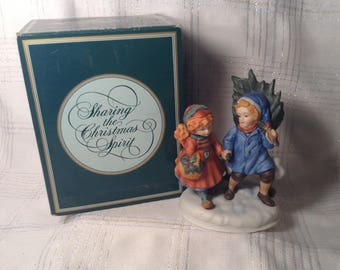"Vintage Avon Porcelain Boy & Girl Figurine with Original Box - 1981 ""Sharing the Christmas Spirit"", of the Christmas Memories Series"
