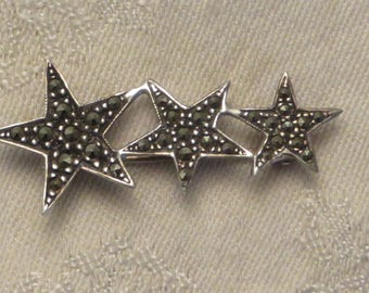 Vintage retro designer signed Bellarri sterling silver marcasite graduated star pin brooch