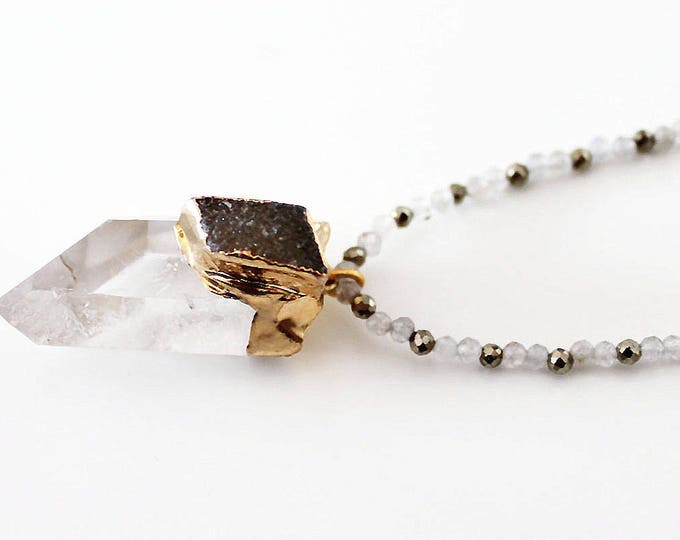 Necklace with a Crystal and quartz pendant