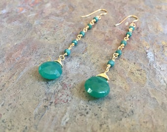 Emerald gemstone gold dangle earrings