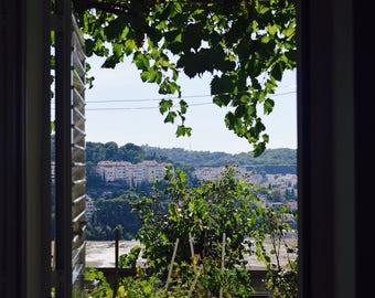 Photo looking over city through doorway