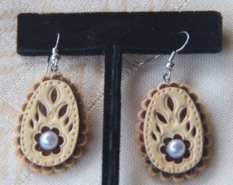 Birch bark earrings .