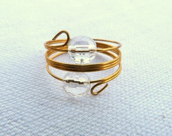 Steel ring gold and natural faceted stones.