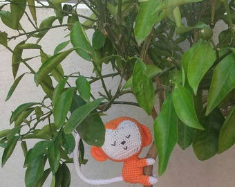 Amigurumi orange monkey crocheted by hand