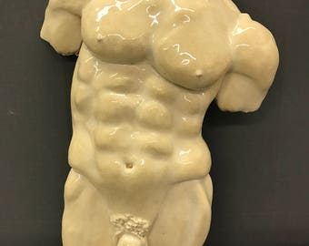 Halb Penis halbe Heilige Statue