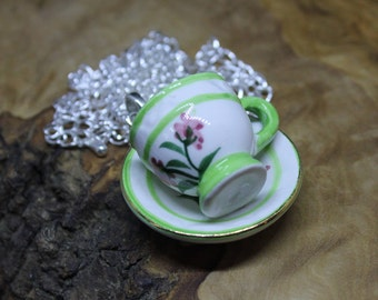 China / porcelain tea cup and saucer, pendant necklace. Hand made, Unique, Upcycled, 1:6th Dolls House accessories. Green and white flower.