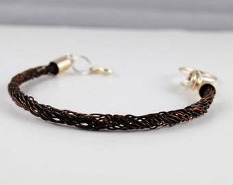 Woven wire kumihimo bracelet braided with antique bronze coloured wire and finished with silver plate end caps