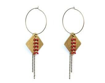 Red spike hoop earrings