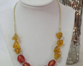 Amber-colored and orange necklace