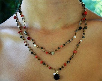 Beaded necklace of coral, pyrite, Swarovski pearls, Black Onyx, black and Pink Rhinestone dangle