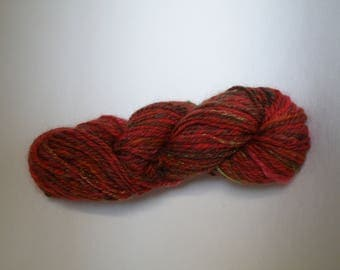 skein of Merino and red silk with light notes of green