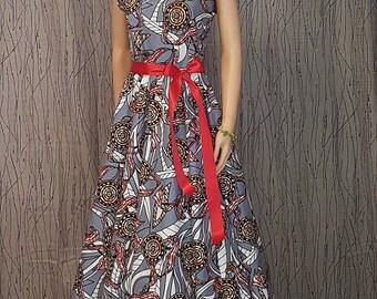 1 long dress made of Wax.  HAND MADE