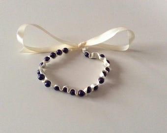 Bracelet made of satin and glass renaissance beads.