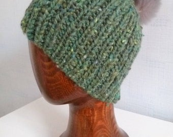Northern spring. Woolen green hat with pompon.
