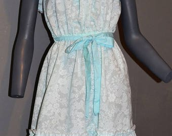 1980s cold shoulder halter sundress by Jodi hills. Mint with white floral print bow tie belt lace and ruffles. Size s Bust 36