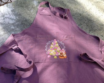 Purple apron with embroidered pouch.