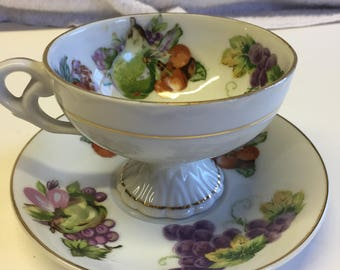 Beautiful old china cup and saucer with gold trim