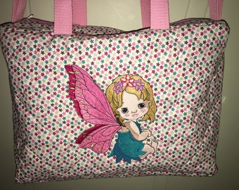 Personalized fairy quilted fabric diaper bag.