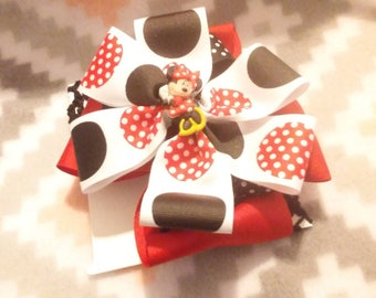 Red, white and black hair bow on a crochet headband