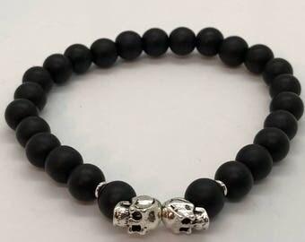 Matte Black Beaded Bracelet with Double Skull